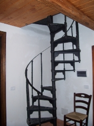Spiral staircase leading to mezzanine