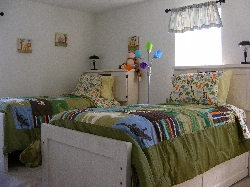 twin bed room with trundle bed