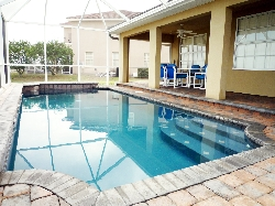 Enjoy a swim in the fully screened pool