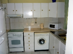 Kitchen with washing machine, dishwasher