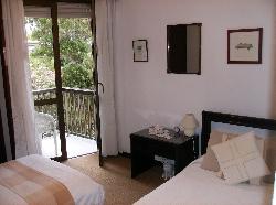 twin bedroom / french door to balcony