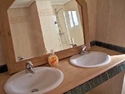 En-suite bathroom has twin wash basins