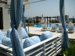 Relax in the Cabana by the pool