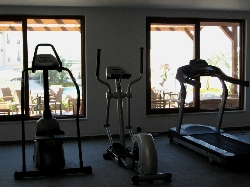 Gym with views of pool and mountains