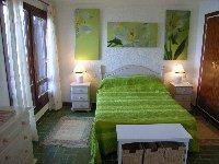 en-suite bedroom with balconey