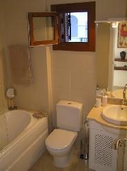 Marble bathroom with jacuzzi bath