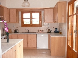 Kitchen with doors leading on to balcony