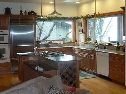 Kitchen - gas cooktop in granite island