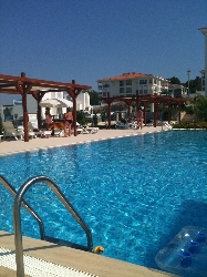 The large pool with lovely sun bed areas