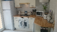 Fully equipped kitchen with back terrace