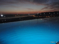 pool at night, overlooking  waterfront
