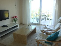 TV corner; patio with sea view outside