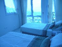 twin room with sea view /balcony door