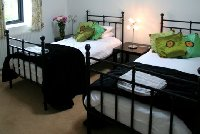Twin bedroom in Poppy Barn (see website)