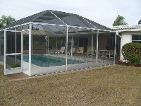 screened pool from rear garden area