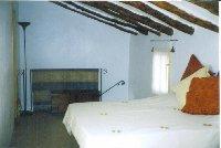 Bedroom 1 with doors to roof terrace