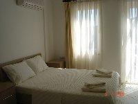 Double bedroom with balcony door