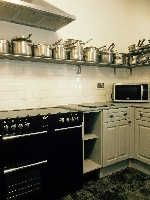 The Kitchen with ample pots and pans.