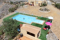 The pool and holiday accommodation