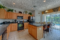 Kitchen showing extended breakfast bar