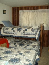 Back bedroom has a queen bed & 2 bunks.