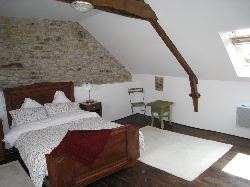 Loft main bedroom with stone walls