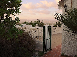 Sun Set  through Gate to Main Villa