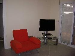 SatelliteTV, DVD & seat in living room