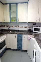 Kitchen of a one bedroomed apartment.