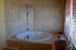 6ft round bath, master suite (lower)