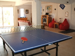 Table tennis in gym and games room